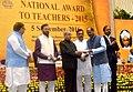 The President, Shri Pranab Mukherjee presenting the National Award for Teachers-2015 to Shri Anil Gajanan Samant (Goa), on the occasion of the 'Teachers Day', in New Delhi.jpg