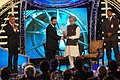 The Prime Minister, Dr. Manmohan Singh giving away the Special Achievement award to veteran actor Kamal Haasan, at the CNN-IBN Indian of the Year Awards 2009 ceremony, in New Delhi on December 21, 2009.jpg