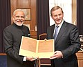 The Prime Minister, Shri Narendra Modi gifting reproductions of manuscripts & papers pertaining to two Irish officials to the Prime Minister of Ireland, Mr. Enda Kenny, at Government Buildings, Dublin on September 23, 2015.jpg
