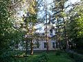 The church of Nativity of Our Lady Theotokos (barely seen through the trees) - panoramio.jpg
