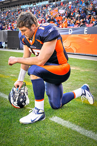 "Tebow kneeling in prayer, which has since been referred to as ""Tebowing"" Tim Tebow Tebowing.jpg"