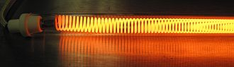 Joule heating - A coiled heating element from an electric toaster, showing red to yellow incandescence