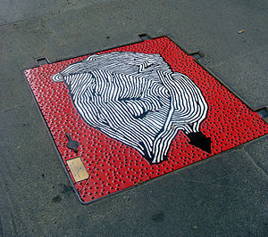 108 (artist) - Manhole cover painted by 108 in Milano, Italy.