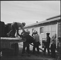 Topaz, Utah. A crew delivering United States Army Number 1 Space Heaters to a resident barracks at . . . - NARA - 538716.tif