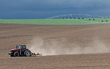 Tractor at work on a field in Idaho (cropped).jpg
