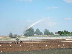 A travelling sprinkler at Millets Farm Centre, Oxfordshire, UK