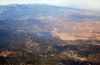 Transverse Ranges - View west of the eastern portion of the San Bernardino and San Gabriel Mountains, with the Mojave Desert on the right and Silverwood Lake near the boundary. The San Andreas Fault runs straight up the middle toward the horizon.