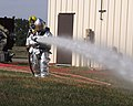 U.S. Air Force firefighters, with the 110th Airlift Wing, Michigan Air National Guard, shoot a fire hose during pump operations at the W.K. Kellogg Airport in Battle Creek, Mich., Aug. 5, 2012 120805-F-LI010-003.jpg