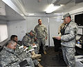 U.S. Army Maj. Gerald Mastin, right, with the 63rd Civil Support Team, Oklahoma Army National Guard, briefs members of the 45th Infantry Brigade Combat Team before search and rescue operations May 21, 2013 130521-Z-BB392-368.jpg