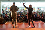 U.S. Navy Adm. James A. Winnefeld Jr., vice chairman of the Joint Chiefs of Staff, and his wife, Mary, wave on stage during a USO concert on Ramstein Air Base, Germany, March 3, 2015 150303-D-KC128-243c.jpg
