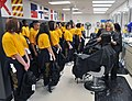 U.S. Navy recruits receive their first haircuts inside the Golden 13 Recruit Inprocessing Center's Navy Exchange Barber Shop at Recruit Training Command (RTC) at Naval Station Great Lakes, Ill. 121120-N-IK959-777.jpg