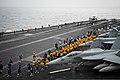 U.S. Sailors participate in a 5-kilometer run on the flight deck of the aircraft carrier USS Nimitz (CVN 68) in the Gulf of Oman Aug. 25, 2013 130825-N-LP801-144.jpg