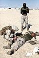 U. S. Marine Corps Lance Cpl. Kristian Fogt with Combat Logistics Company, Combat Logistics Regiment 2, 2nd Marine Logistics Group, practices lifesaving skills on a simulated casualty as she undergo combat 120905-M-KS710-029.jpg