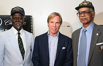Tommy Hilfiger - World War II veterans, Petty Officer 1st class Lorenzo A. DuFau, a former signalman, and Petty Officer 2nd class James W. Graham of USS Mason, with Tommy Hilfiger during the screening of Proud at the Apollo Theater in 2005