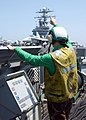 US Navy 020429-N-6653S-004 Final launch signal for F-A-18 aboard CVN 73.jpg
