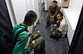 US Navy 021003-N-4309A-010 While others enjoyed their steel beach picnic on the flight deck or playing various sports, these crewmembers took the opportunity to play their guitars together in a passageway aboard the ship.jpg