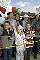 US Navy 030425-N-1995C-002 Family members and friends cheer as USS Mobile Bay (CG 53) docks at Naval Station San Diego.jpg