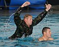 US Navy 030503-N-8209D-086 A Basic Underwater Demolition-SEAL (BUD-Sea, Air, Land) Instructor is about to show a member of BUD-S Class 244 just how hard it can be to rescue a drowning victim.jpg