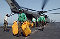 US Navy 030613-N-5362A-001 Personnel assigned to the cargo division (S-8) aboard USS Nimitz (CVN 68) unload mail from an MH-53E Sea Dragon assigned to the Blackhawks of Helicopter Mine Countermeasures Squadron Fifteen (HM-15).jpg