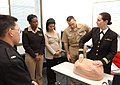 US Navy 040121-N-0000W-123 Using a model torso, Labor and Deliver Nurse Lt. Kristin Berndt, assigned to U.S. Naval Hospital Okinawa, helps nurses in Yokosuka learn advanced techniques in fetal monitoring.jpg