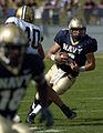 US Navy 040925-N-9693M-008 U.S. Naval Academy Midshipman 21st Class Aaron Polanco evades Vanderbilt linebacker Kevin Joyce.jpg