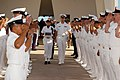 US Navy 040930-N-4995T-001 Chief Petty Officer's assigned to various commands in the Hawaii area, salute as the remains of Chief Machinist's Mate Anthony Francis Czarnecki are taken aboard the USS Arizona Memorial.jpg