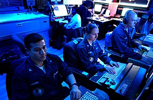 Global Command and Control System - Operations Specialists monitor (GCCS) in the Combat Direction Center (CDC) aboard the Nimitz-class aircraft carrier USS ''John C. Stennis'' (CVN-74).