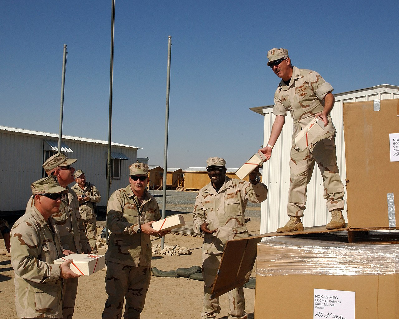 File:US Navy 041211-N-6812T-001 Master Chiefs hand out Christmas ...