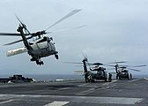 US Navy 050101-N-6817C-028 Helicopters depart USS Abraham Lincoln (CVN 72) en route to Aceh, Sumatra, Indonesia.jpg