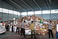 US Navy 050104-M-9792P-001 A huge pile of humanitarian aid waits to be sorted and distributed in a hanger at the Palonia Air Field in Medan, Indonesia.jpg