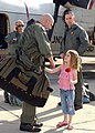 US Navy 050228-N-7615S-019 Lt. Cmdr. Chris Marlar reunites with his daughter after returning home to San Diego, Calif., from deployment.jpg