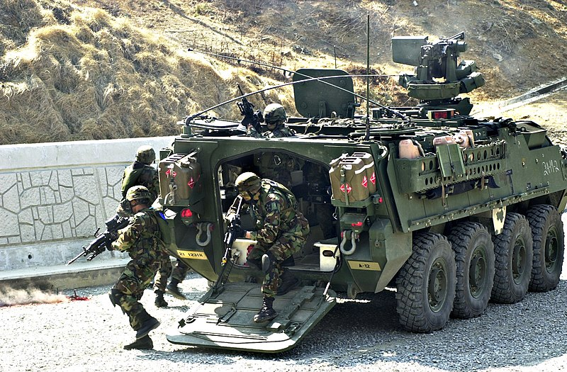 https://upload.wikimedia.org/wikipedia/commons/thumb/2/2a/US_Navy_050320-N-9588P-027_U.S._Army_Soldiers_ploy_out_of_the_back_of_a_Stryker_infantry_carrier_vehicle_to_provide_suppressive_fire_on_the_enemy_during_a_simulated_convoy_attack.jpg/800px-thumbnail.jpg