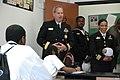 US Navy 050425-N-7975R-011 Commander, Navy Recruiting Command, Rear Adm. Jeffrey Fowler, left, visits students at the Mathematics, Civics and Sciences Charter School of Philadelphia Inc., (MCSCS) during Philadelphia's Nav.jpg