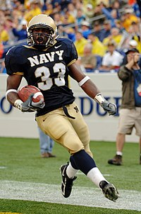 US Navy 051008-N-9693M-008 U.S. Naval Academy Midshipman slot back Karlos Whittaker crosses the goal line to score Navy's sole first half touchdown against the Air Force Falcons.jpg