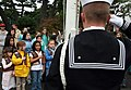 US Navy 051111-N-1113S-002 Four Brownie Girl Scouts render honors as Builder Constructionman Jason Bowman salutes during the raising of colors as part of the Naval Air Facility Atsugi Veterans Day observance.jpg