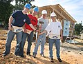 US Navy 060526-N-3271W-001 Sailors assigned to the Los Angeles-class fast attack submarine USS Charlotte (SSN 766) assist with construction of a Habitat for Humanity home.jpg