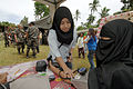 US Navy 060529-N-6501M-013 A young Muslim volunteer checks a local Filipino woman's vital signs while participating in a Medical Civil Action Program (MEDCAP) located on Basilan Island.jpg