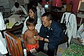 US Navy 060601-N-9076B-078 Navy Cmdr. Jesus Mallari, originally from the Philippines, listens to a little boy's heart during a clinic visit in the pediatric ward at Zamboanga Medical Center.jpg