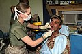 US Navy 060622-M-3658J-040 U.S. Navy Hospital Corpsman 3rd Class Sondra R. LaForge assigned to 1st Dental Battalion, Combat Logistics Battalion-5 (CLB-5), 1st Marine Logistics Group (1MLG) takes an x-ray.jpg