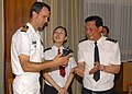 US Navy 060627-N-9860Y-144 Rear Adm. Wang Deding, right, commander, Shanghai Naval Base, presents the Commanding Officer for the U.S. Navy's amphibious command ship USS Blue Ridge (LCC 19), Capt. Jeff Bartkoski, with a decorati.jpg
