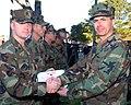 US Navy 070109-N-4014G-010 Rear Adm. James Barnett, Jr. shakes hands with Mass Communication Specialist Chief Tom Jones after awarding him a Bronze Star medal, during an awards presentation ceremony at Naval Station Norfolk.jpg
