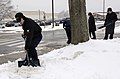 US Navy 070226-N-8467N-002 Machinist's Mate 3rd Class Michael Kilpatrick shovels snow from the sidewalks at Submarine Base New London.jpg
