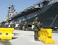 US Navy 070306-N-4614W-018 A Republic of Korea soldier stands watch on the pier, in front of USS Essex (LHD 2), during 31st Marine Expeditionary Unit reception staging onward movement and integration for Exercise Foal Eagle 200.jpg