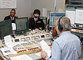 US Navy 070430-N-7006N-004 Rear Adm. Karen Flaherty, Deputy Commander, Navy Medicine, National Capital Area, and Lt. Wallace Dawkins of Navy Office of Community Outreach enjoy time on the air.jpg