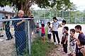 US Navy 070826-N-4124C-037 Japanese children watch as Damage Controlman 1st Class Robert G. Beckwith repairs a fence as part of a visit by Sailors of the USS Juneau (LPD 10) to the Tenshin-ryo Children's Home.jpg