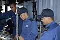 US Navy 071114-N-XXXXS-001 Sailors attached to the Japan Maritime Self-Defense Force (JMSDF) learn about ship handling tactics from helmsman, Boatswain's Mate Seaman Walter Hurd, aboard the guided-missile cruiser USS Cowpens (C.jpg