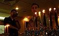 US Navy 071208-N-0455L-003 Machinist's Mate 3rd Class Jesse Kopelman and Nimitz-class aircraft carrier USS Harry S. Truman (CVN 75), Commanding Officer, Capt. Herman Shelanski sings from the Torah during a Chanukah celebration.jpg