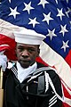 US Navy 071215-N-8327B-002 Yeoman Seaman Eric Warren, a member of the Naval Support Activity Panama City Color Guard carries the American flag during the commissioning ceremony for USS Mesa Verde (LPD 19).jpg