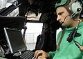 US Navy 080710-N-5681S-024 Aviation Electronics Technician 2nd Class David Melton, assigned to Helicopter Squadron Composite (HSC) 26, troubleshoots a radio discrepancy on an MH-60S Seahawk.jpg