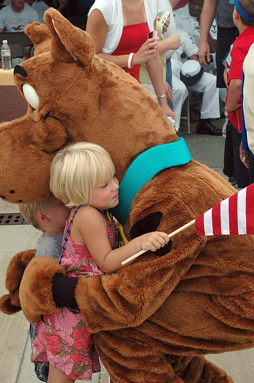 US Navy 080711-N-5307M-005 A Navy dependent hugs Scooby Doo while waiting for her father to return from a deployment aboard the amphibious assault ship USS Nassau (LHA 4)